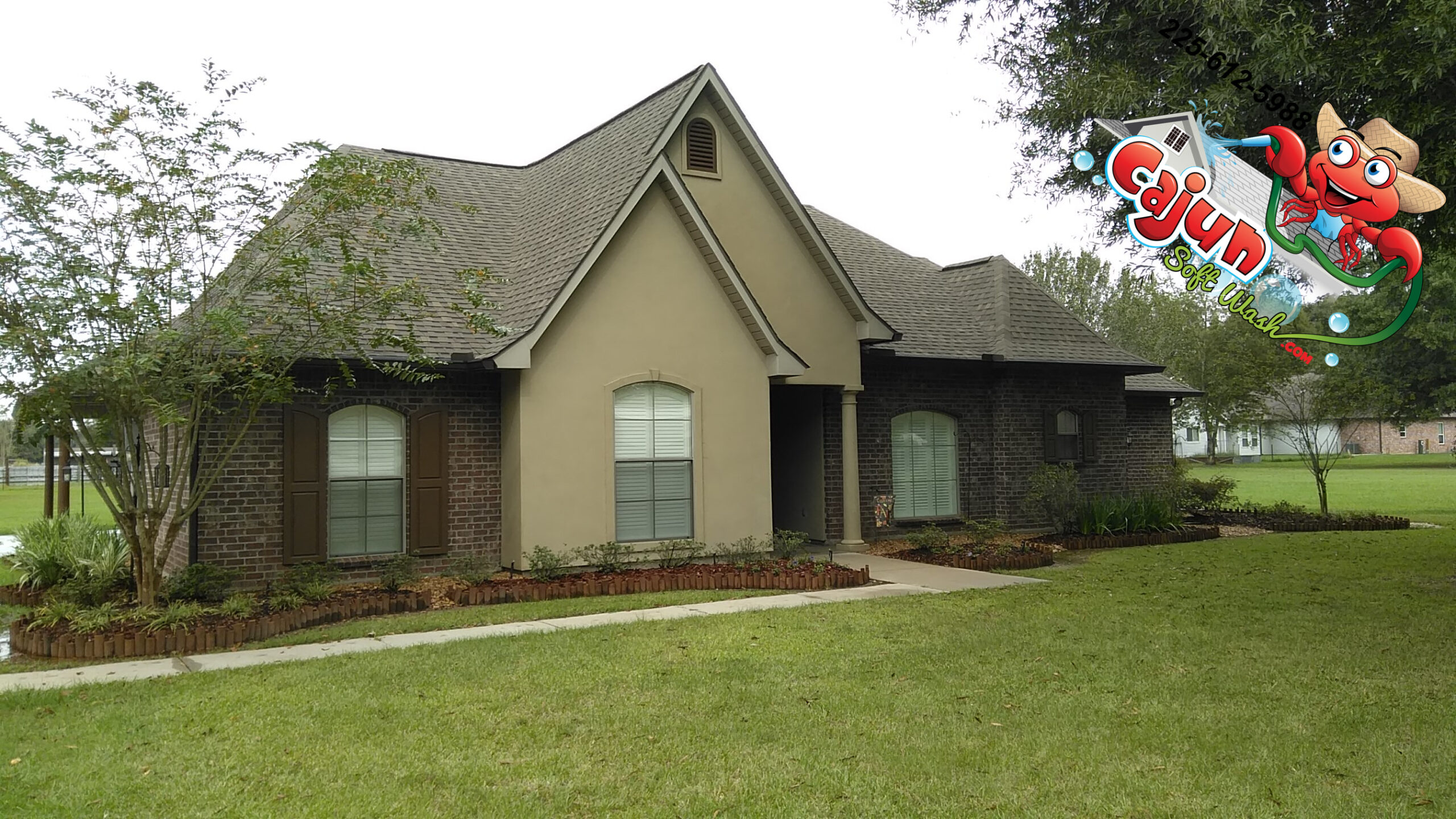 Cajun Soft Wash residential roof cleaning exterior dirt stain window