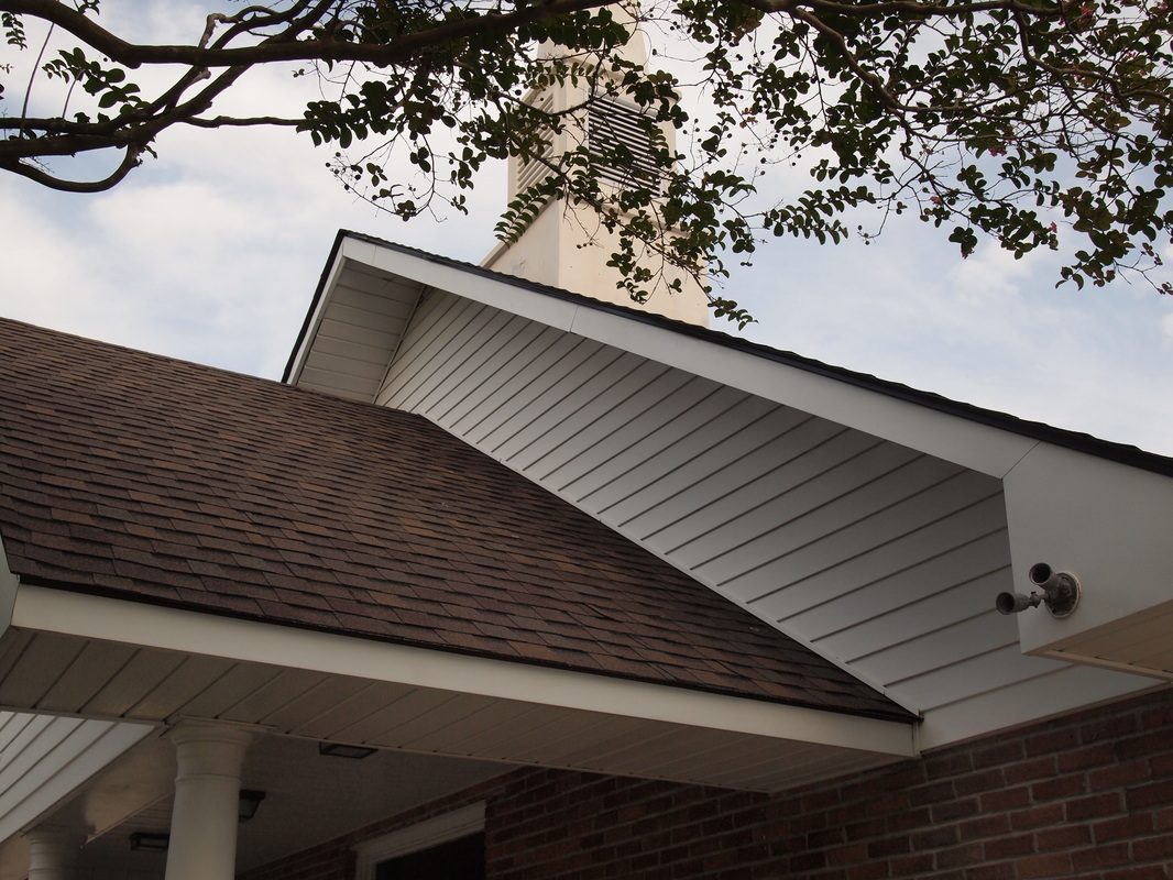 Cajun Soft Wash steeple cleaning soft power wash dirt stain